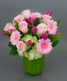 We will take our most beautiful roses, tulips, gerbera daisies, hydrangea, and cymbidium orchids and create a masterpiece in a soft color pallette.