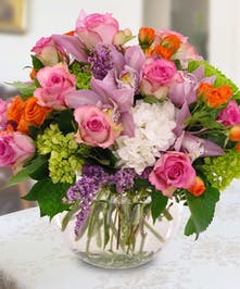 A soft collection of pinks, whites, greens and a hint of orange designed in a bowl.