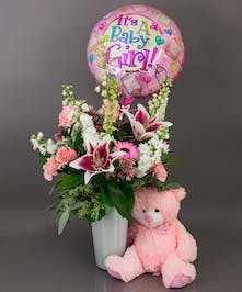 This beautiful vase of assorted fresh cut flowers is just right for the celebration of your new arrival.