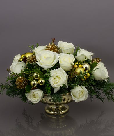 The Biltmore centerpiece will be the talk of the party with it's beautiful gold container, elegant white roses and beautiful seasonal evergreens.