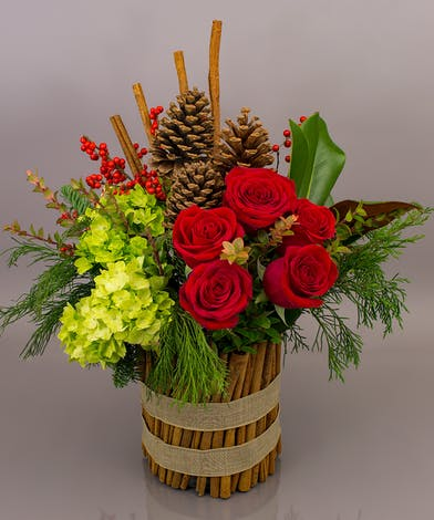 Filled with evergreens, hydrangea, roses and berries, the Cinnamon Spice arrangement will spice up the holidays....for sure.