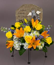 We will create a beautiful floral floral arrangement to celebrate a loved one and display your selected memorial plaque above it in our display stand.