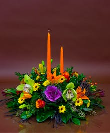 We will combine a beautiful collection of fresh seasonal flowers and candles for a truly stunning centerpiece.