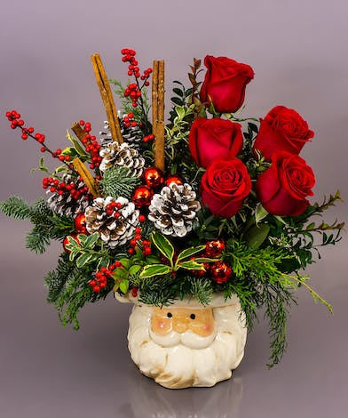 This year's signature ceramic piece is a substantial arrangement of mixed evergreens roses or carnations, cinnamon sticks, pine cones and baubles.