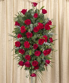 One of our most popular expressions of sympathy for a loved one. A classic design of red roses.