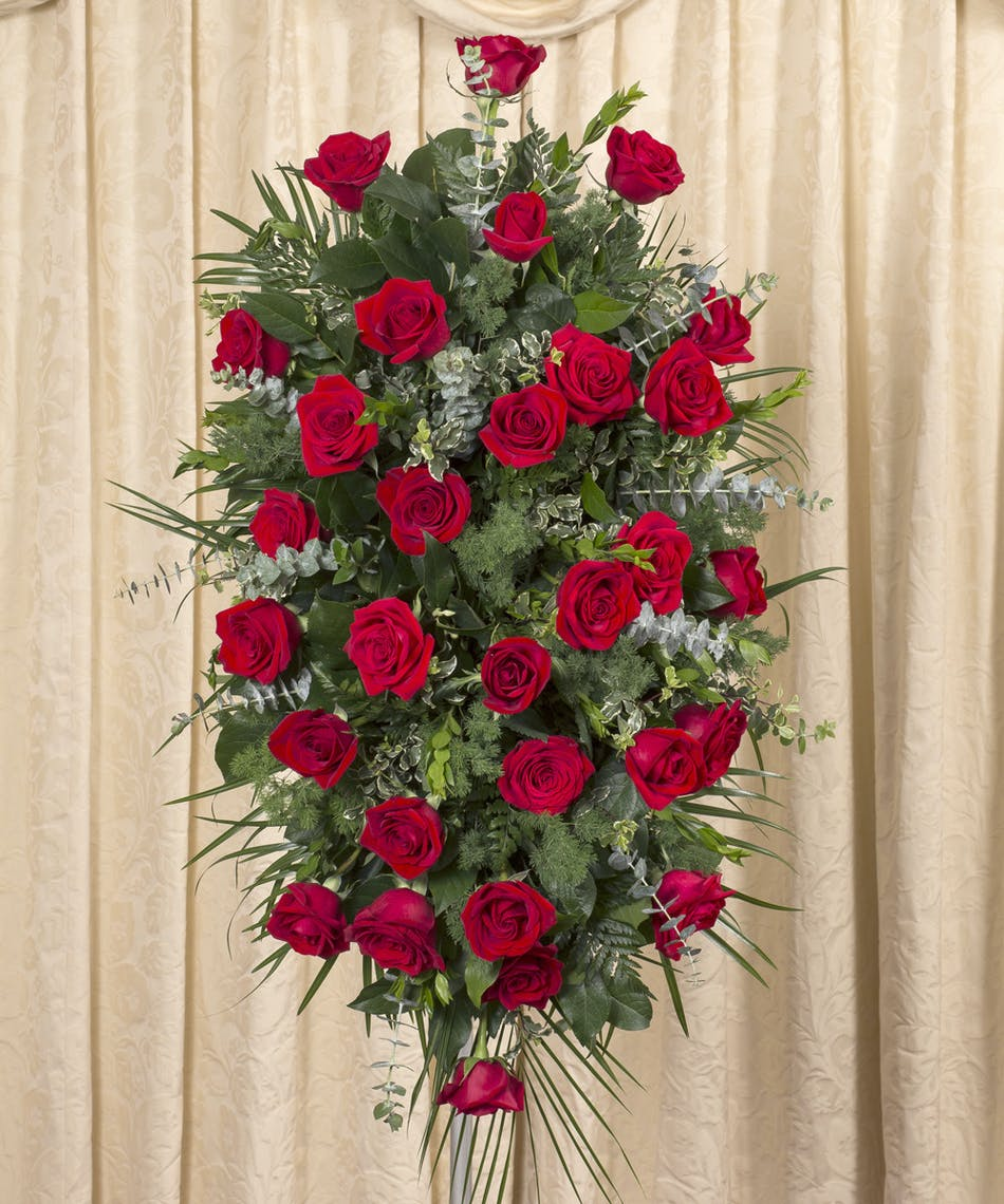 Red rose standing spray flower delivery by currans flowers one of our most popular expressions of sympathy for a loved one a classic design izmirmasajfo
