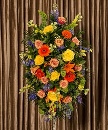 A beautiful collection of bold and bright flowers designed in an impressive display designed to celebrate a vibrant life.