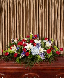 A fitting casket spray that pays tribute to those that have selflessly served our country.