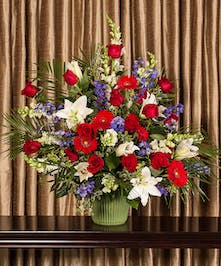 A patriotic collection of beautiful flowers designed in an impressive display for the service.
