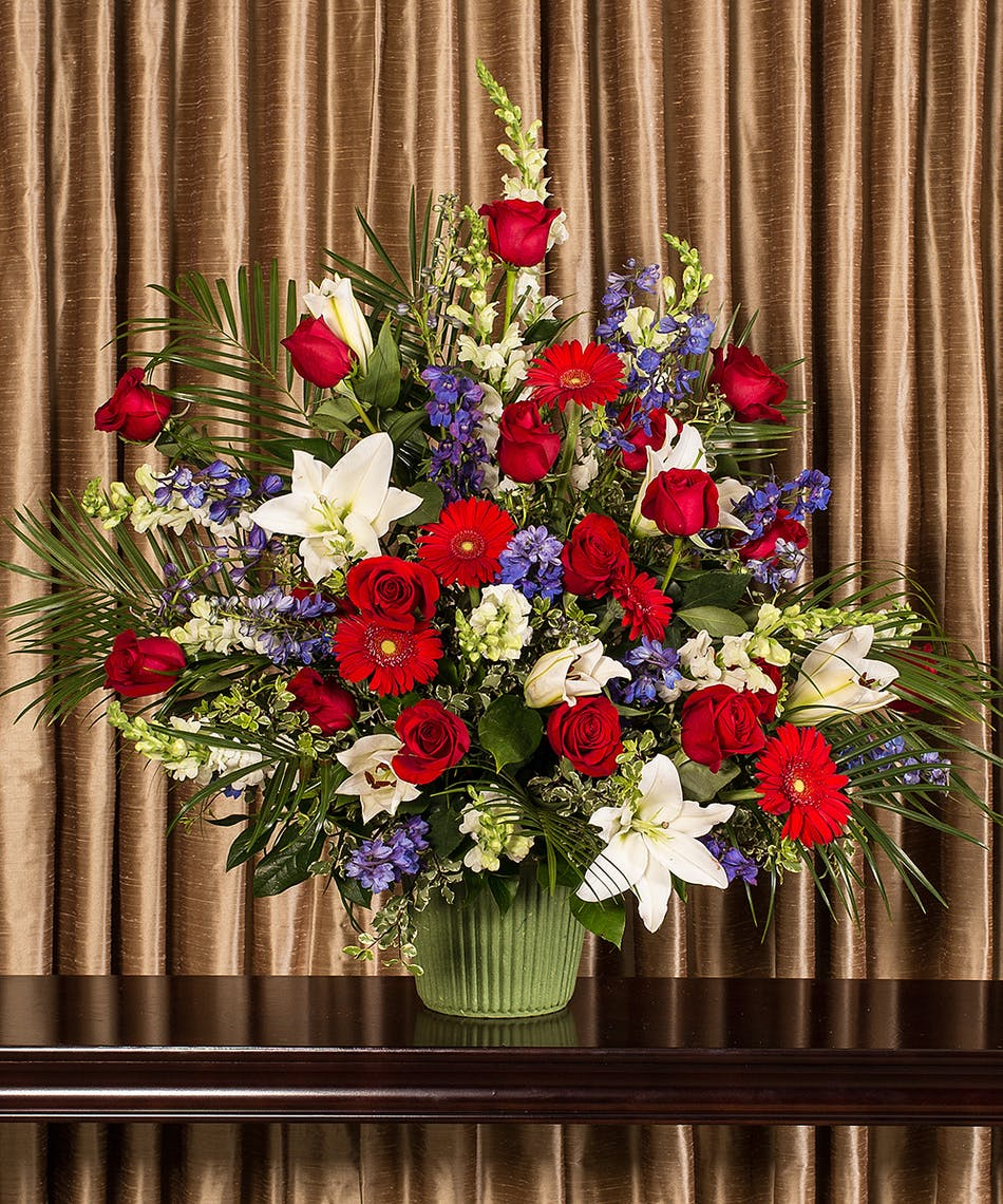 Patriotic funeral basket same day delivery danvers ma currans a patriotic collection of beautiful flowers designed in an impressive display for the service izmirmasajfo