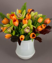We have designed premium Adrem tulips and photinia foliage in our exclusive imported Tokyo vase to create this beautiful arrangement.