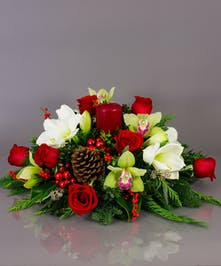 Our long lasting table centerpieces are designed from a variety of fresh cut winter greens, amaryllis, roses, orchids, and berries.