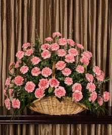 A beautiful collection of pink carnations artfully designed to create a large display.