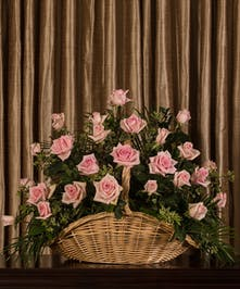 A beautiful collection of pink roses artfully designed to create a large display.