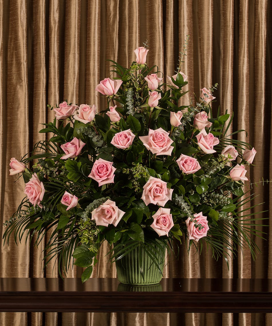 Pink rose funeral basket same day delivery danvers ma currans a beautiful collection of pink roses artfully designed into an impressive display for the service izmirmasajfo