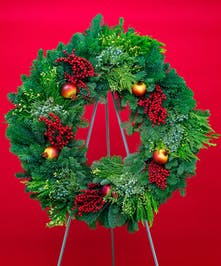 Handcrafted from premium evergreens, and adorned with a clusters of pomegranate and berries this lush wreath will be enjoyed throughout the season.