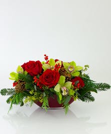 We've combined roses orchids in a beautiful dutch glass centerpiece bowl for this beautiful arrangement.