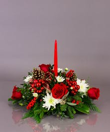 Our long lasting table centerpieces are designed from a variety of fresh cut winter greens, carnations, and berries.