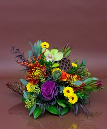 We will combine a beautiful collection of fresh seasonal flowers in a traditional cornucopia.