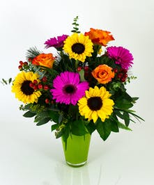 A beautiful combination of roses, hydrangea, and sunflowers, everyone will welcome there Vibrance Vase into their home or office.