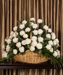 A beautiful collection of white carnations artfully designed to create a large display.