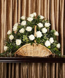 A beautiful collection of white roses artfully designed to create a large display.