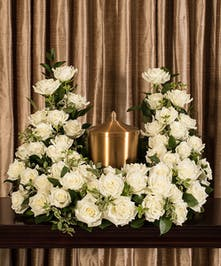 A beautiful collection of white roses artfully designed to embrace the memorial urn. Cut Phalaenopsis Elegance Vase