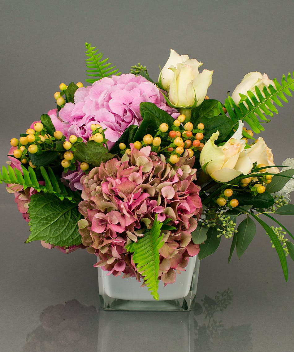A classic collection of ever popular hydrangea from Holland and beautiful roses accented with seasonal foliage is appropriate for any occasion.